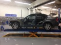 BMW 325i during repair on Car-o-liner bench